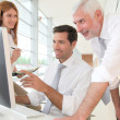 Office workers with manager in a meeting — Stock Photo #5696942