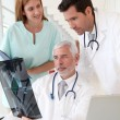 medical team checking xray — Stock Photo
