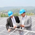 Engineers checking solar panels setup — Stock Photo #5697248