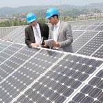 Engineers checking solar panels setup — Stock Photo #5697252