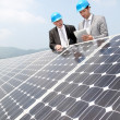 Engineers checking solar panels setup — Stock Photo #5697254