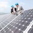 Engineers checking solar panels setup — Stock Photo #5697255