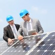 Stock Photo: Engineers checking solar panels setup