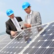 Engineers checking solar panels setup — Stock Photo #5697257