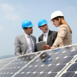 Engineers checking solar panels setup — Stock Photo #5697270