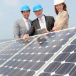 Engineers checking solar panels setup — Stock Photo #5697272