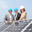 Engineers checking solar panels setup — Stock Photo #5697273