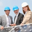 Engineers checking solar panels setup — Stock Photo #5697274
