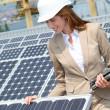 Woman engineer checking solar panels setup — Stock Photo #5697284