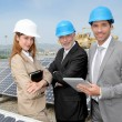 Engineers checking solar panels setup — Stock Photo #5697294