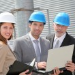 Business meeting on industrial site — Stock Photo