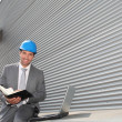 Stock Photo: Businessmchecking industrial installation