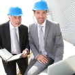 Business partners working on industrial site — Stock Photo #5697307