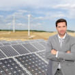 Businessman standing by photovoltaic installation — Stock Photo