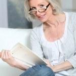 Portrait of senior woman reading book — Stock Photo #5697446