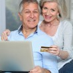 Senior couple doing online shopping — Stock Photo