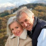 Portrait of happy senior couple in countryside — Stock Photo #5697716