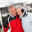 Senior couple at ski resort — Stock Photo #5697883