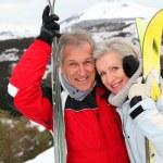 Senior couple at ski resort — Stock Photo #5697885