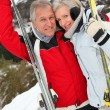 Senior couple at ski resort — Stock Photo #5697888