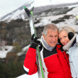 Senior couple at ski resort — Stock Photo #5697889