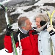 Senior couple at ski resort — Stock Photo