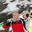 Senior couple at ski resort — Stock Photo #5697898