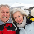 Senior couple at ski resort — Stock Photo