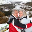 Senior couple having fun at ski resort — Stock Photo #5697916