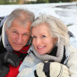 Senior couple having fun at ski resort — Stock Photo #5697918