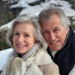Portrait of happy senior couple at the mountain — Stock Photo