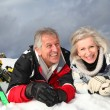 Senior couple having fun at ski resort — Stockfoto #5697952