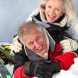 Senior couple having fun at ski resort — Stock Photo #5697955