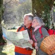 Senior couple with map on a hiking day — Stock Photo #5698039