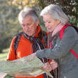 Senior couple with map on a hiking day — Stock Photo