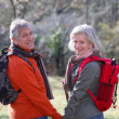 Closeup of senior couple hiking in countryside — Stock Photo #5698049