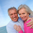 Closeup of senior couple by the sea — Stock Photo #5698078