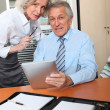 Senior business in the office with electronic pad — Stock Photo