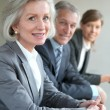 Stock Photo: Portrait of business team standing in office