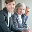 Portrait of business team standing in office — Stock Photo #5698192