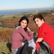 Couple hiking in countryside on beautiful fall day - Foto de Stock