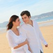 Portrait of lovely couple walking on the beach — Stock Photo