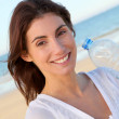 Portrait of beautiful smiling woman at the beach — Stock Photo #5698490