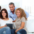 Group of friends sitting in sofa — Stock Photo