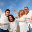 Stock Photo: Group of friends having fun at beach