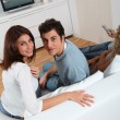 Couple at home watching television — Stock Photo