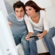 Couple playing video games at home — Stock Photo #5698995