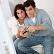 Couple playing video games at home — Stock Photo #5699000