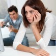 Young woman fed up with boyfriend playing video game — Stock Photo #5699002