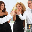 Group of friends cheering with glasses of champagne — Stock Photo #5699004